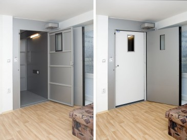 The cabin in the basement - double lift doors provide insulation.